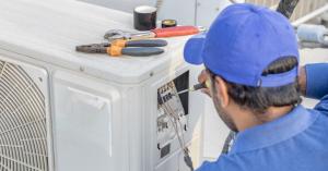 HVAC technician inspecting air conditioning unit